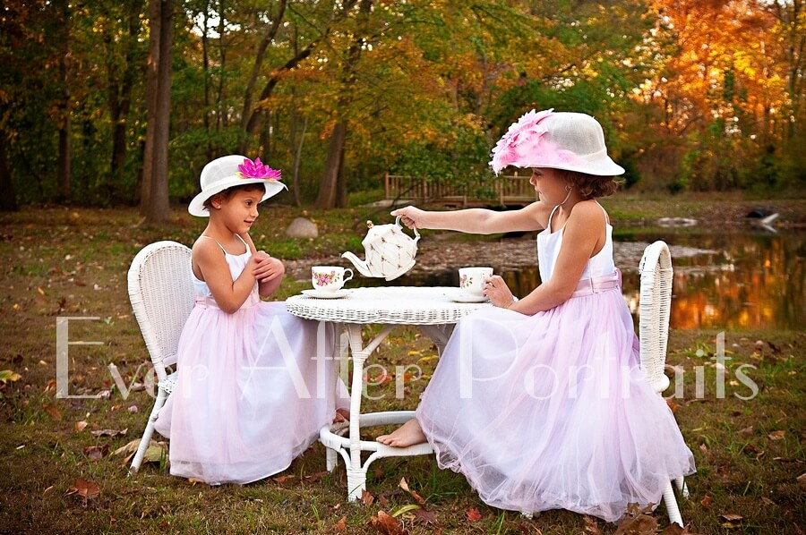 portrait photography sisters in dresses outdoor tea party.