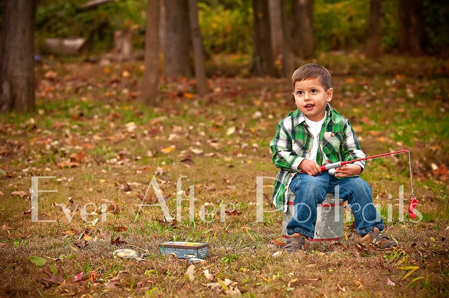Little boy with fishing pole by the pond.