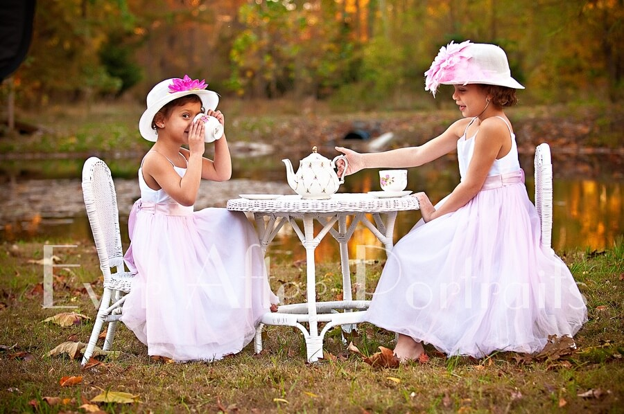 portrait photography Siblings enjoying an outdoor tea party sipping tea