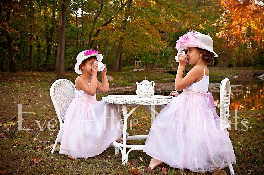portrait photography Two girls sipping tea at their party in the outdoor studio
