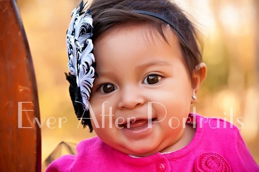 Adorable little girl smiling her closeup portrait.