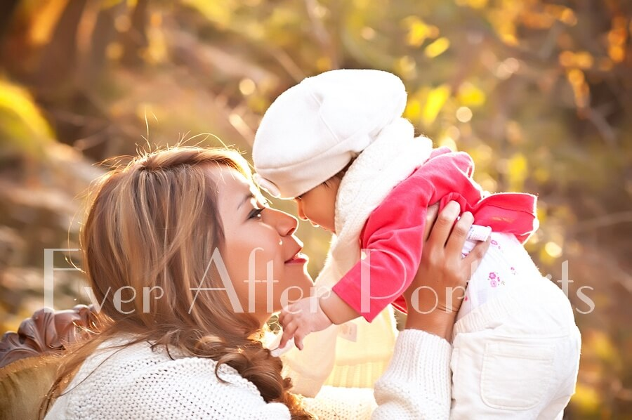 Aunt with her little niece in outdoor image.