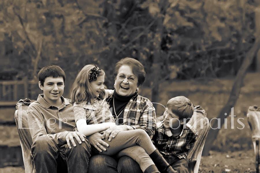 Grandma on sofa with three grandchildren.