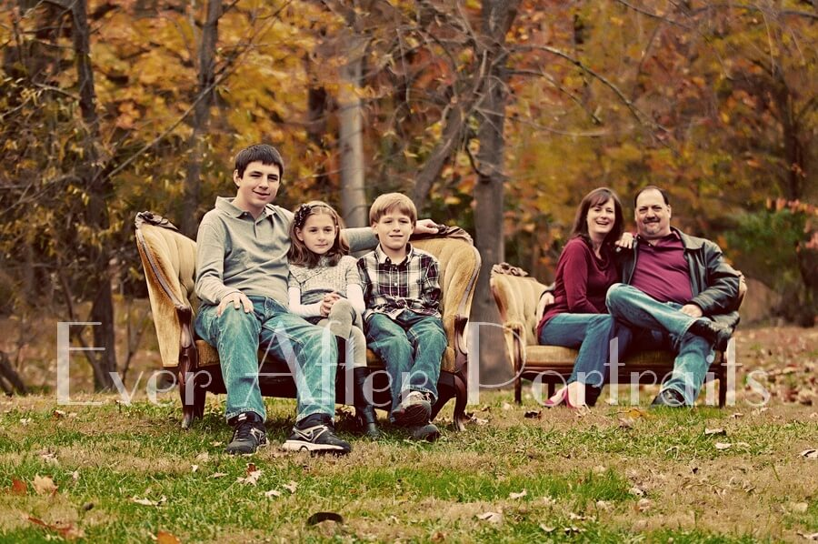 Family of five in outdoor sofa portrait.