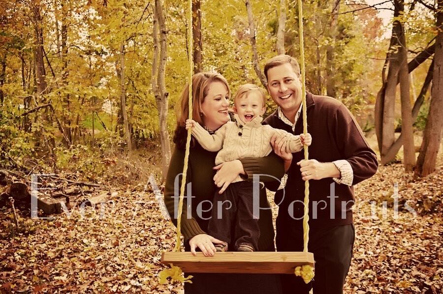 Family on swing in Northern VA outdoor studio.