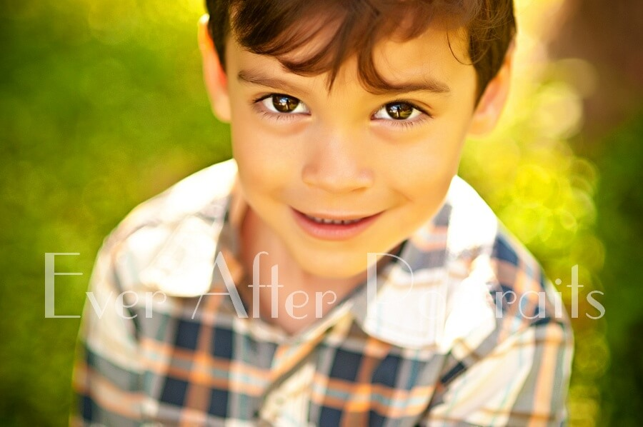 Closeup of four year old in plaid shirt.