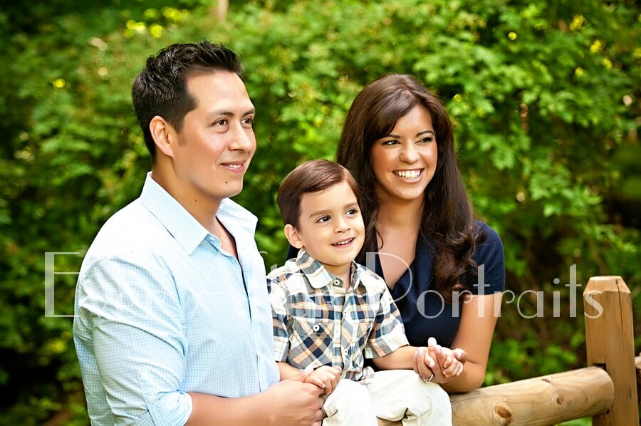 Family of three in outdoor image.