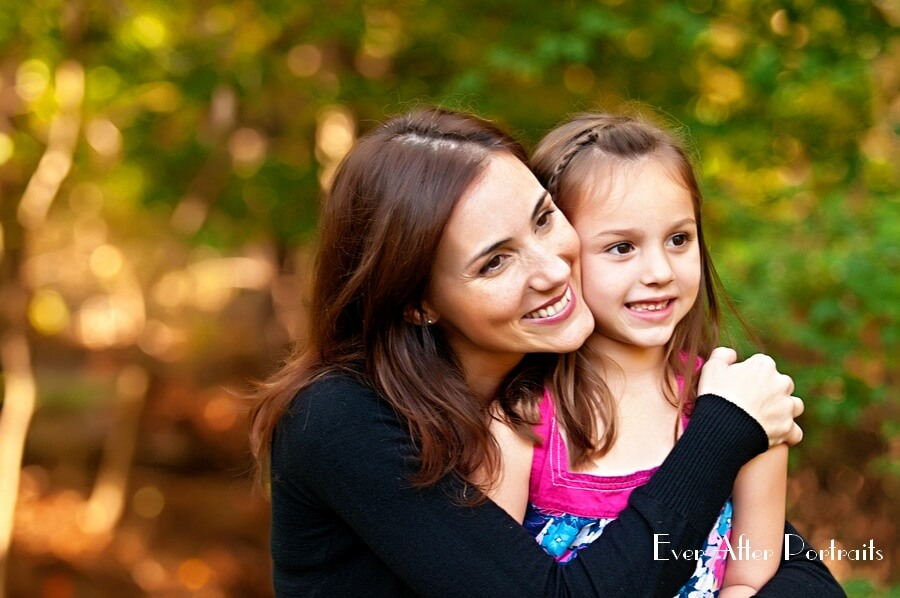 Mother and daughter hug in closeup image.