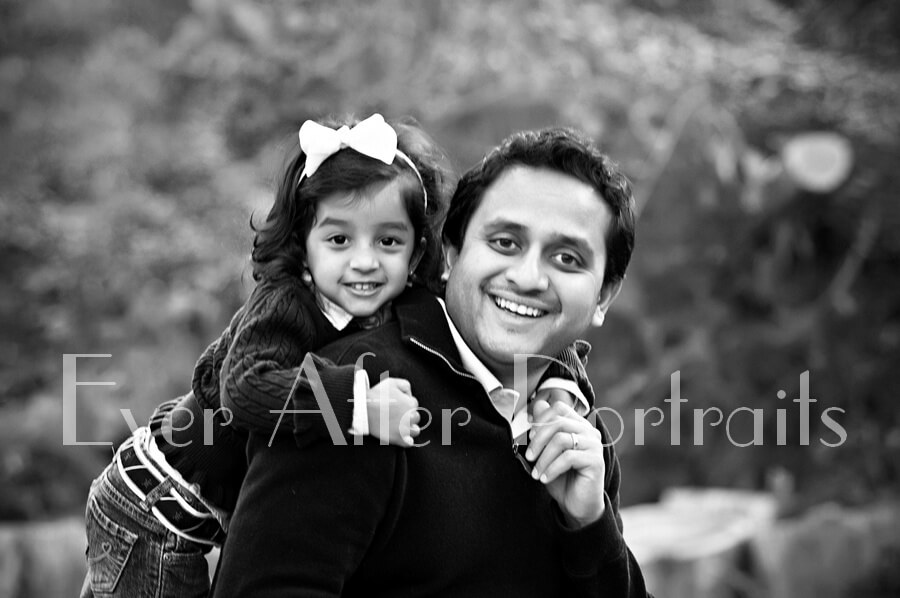 Father and 2 year old daughter in autumn image.