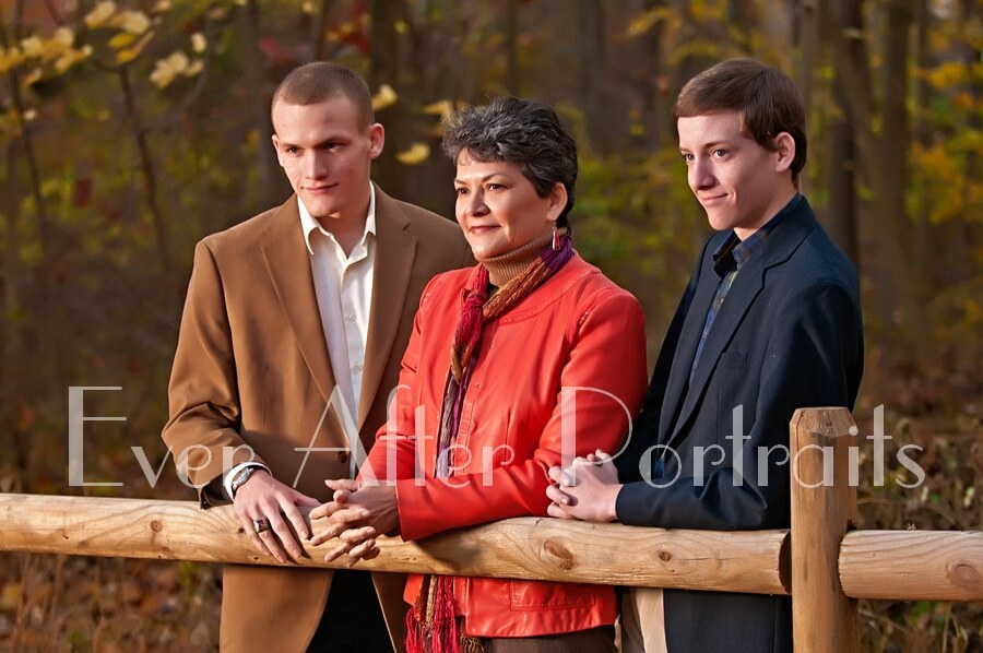 Family of three outdoor portrait