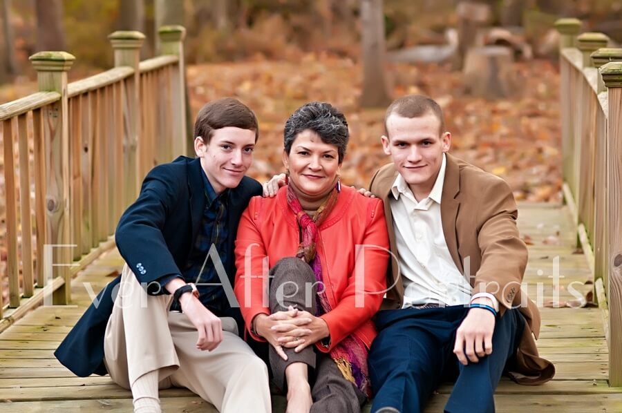 Mother with grown sons in outdoor image.