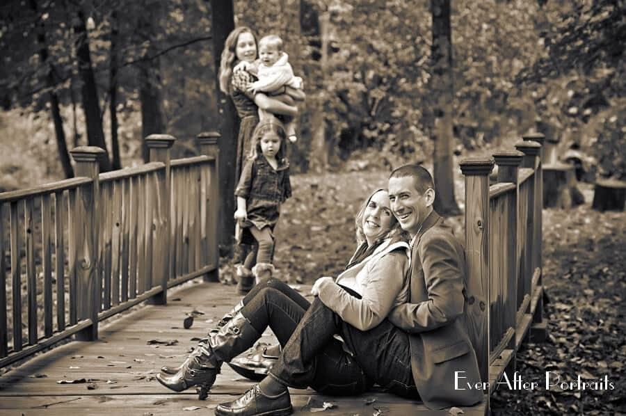 Family of five enjoying autumn on a bridge.