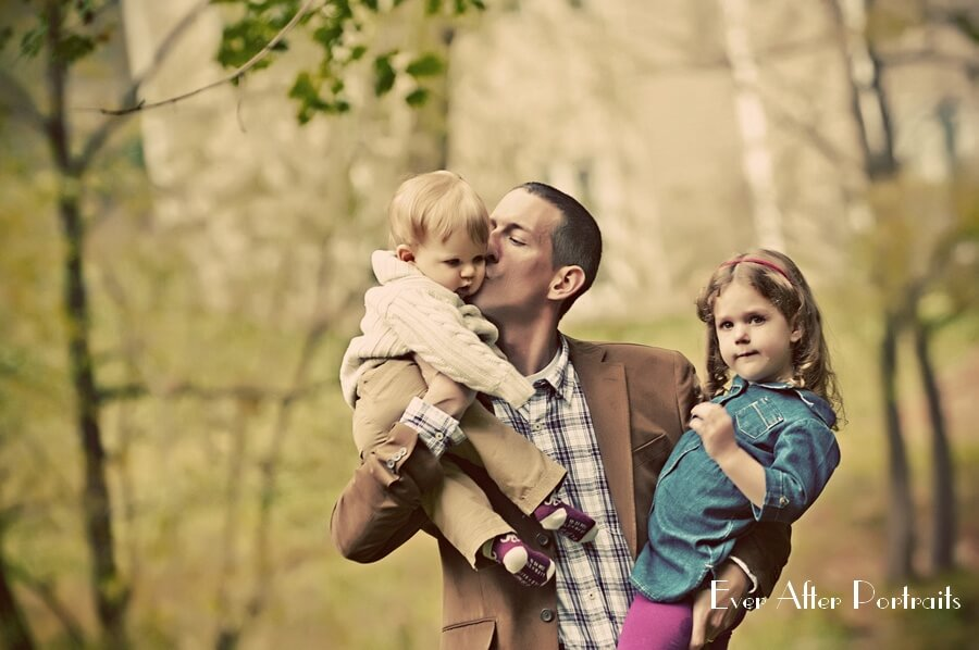 Father holding one year old son and three year old daughter.
