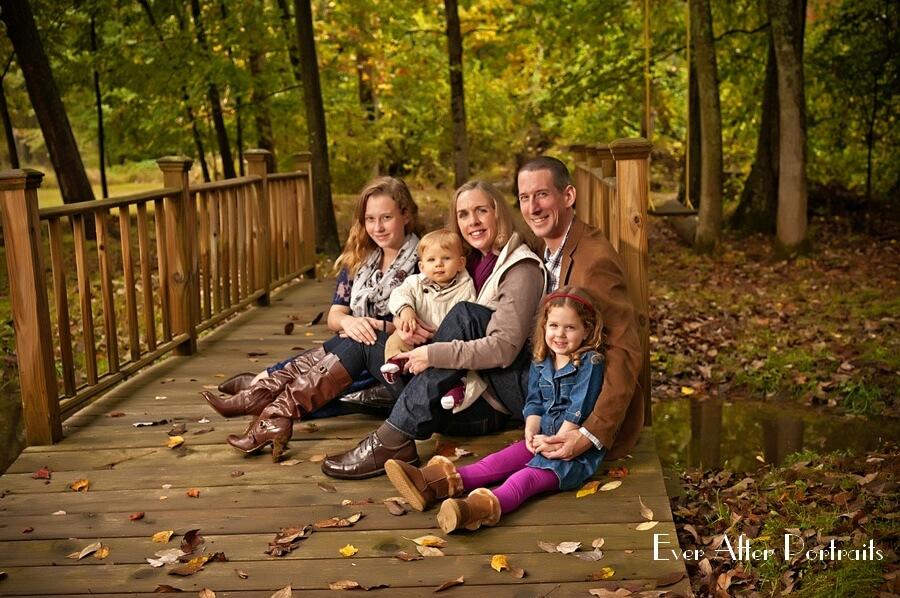 Parents with three children in outdoor portrait.