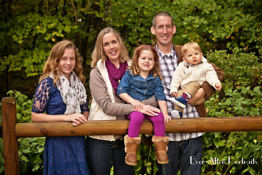 Family of five in outdoor image.