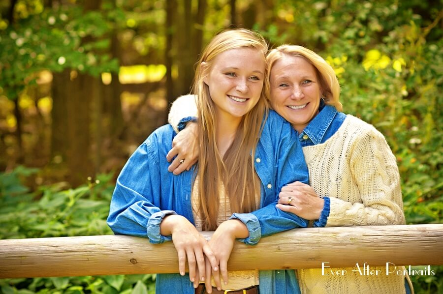 Mother and daughter in the woods.